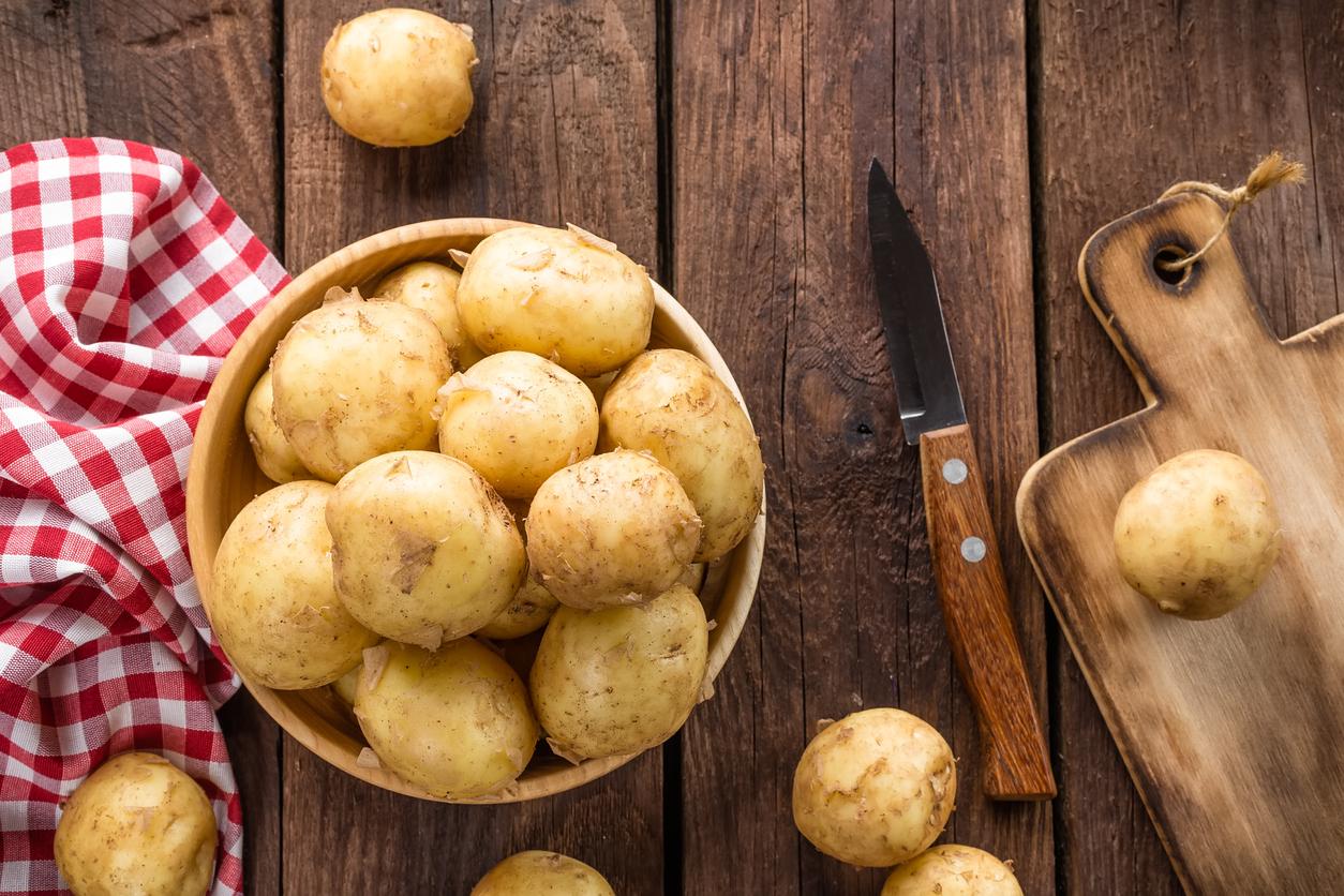 Bowl of uncooked potatos