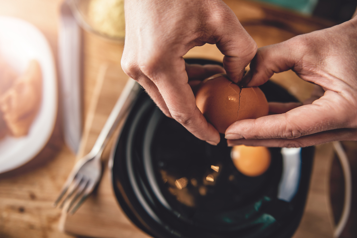 Cracking eggs into a bowl