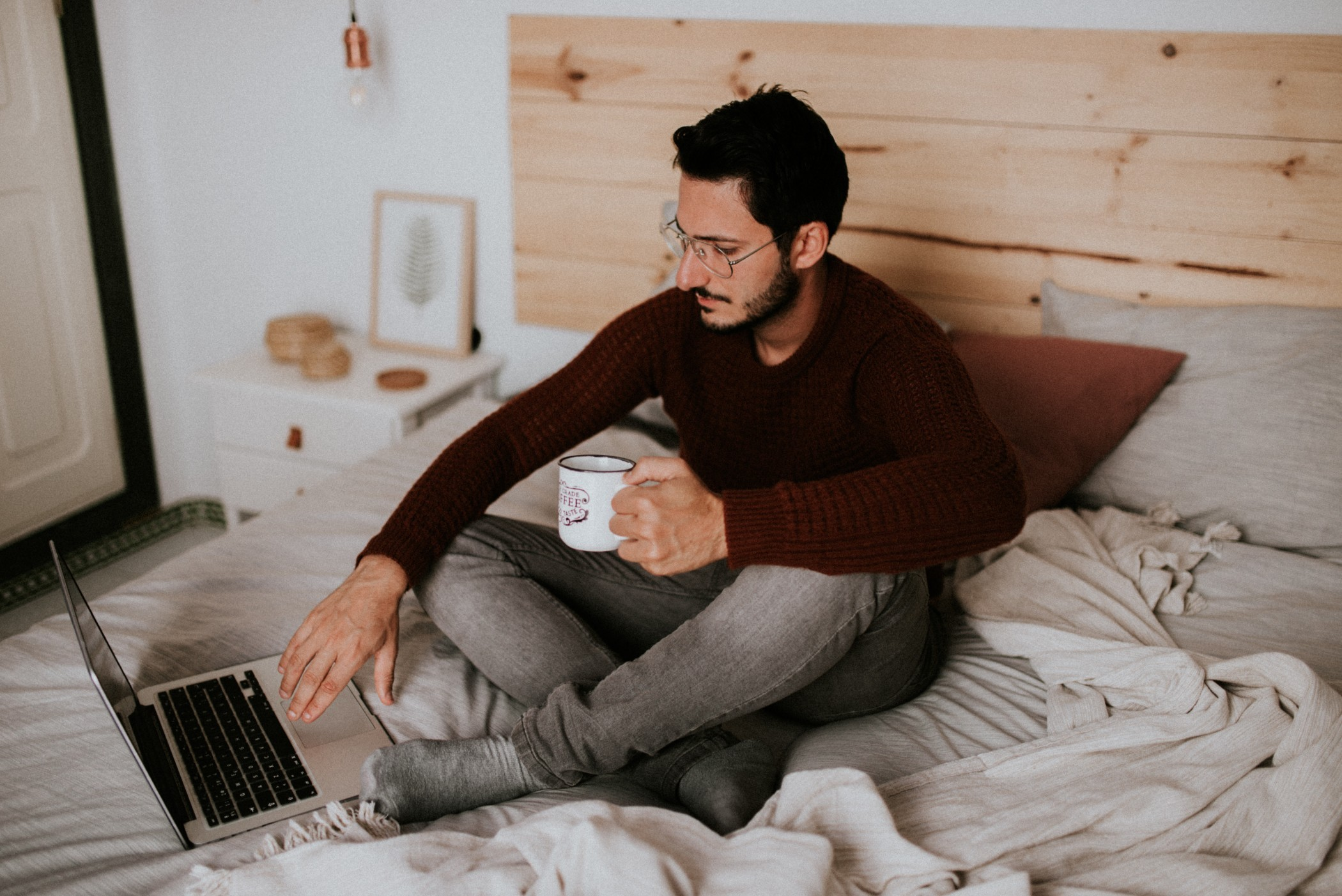 Young man on a laptop in bed